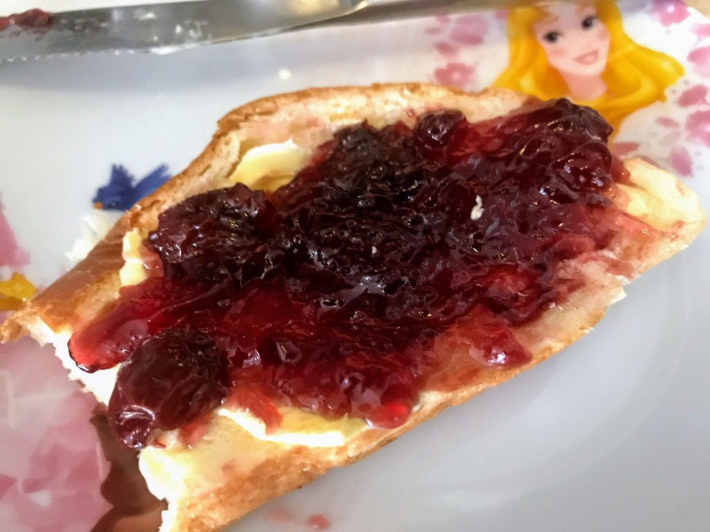 white bread with cherry jam and butter